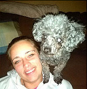 girl with grey toy poodle on her shoulder